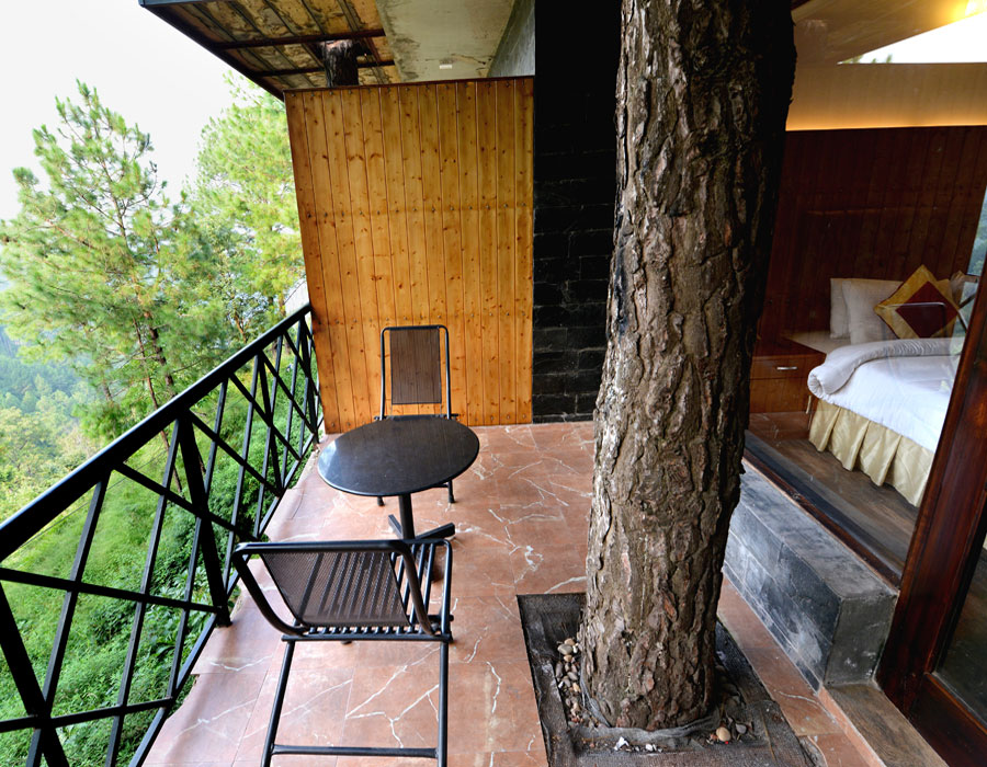 kasauli-hills-resort-deluxe-room-valley-facing-rooms-cottages-accommodation-suites-interior-valley-facing-views-balcony-lounge-valley-facing-view
